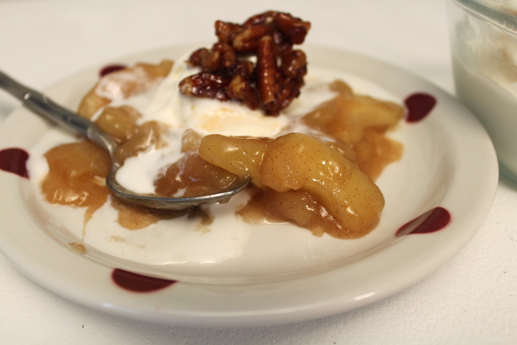 Warm cinnamon apples with vanilla ice cream melting into the fruit, topped with candied pecans for our dessert. Yummmmmmm.